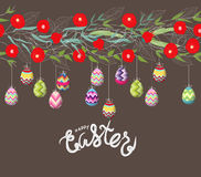 Easter eggs hanging on the florals Royalty Free Stock Image