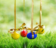 Easter eggs hanging on golden ribbons Royalty Free Stock Images