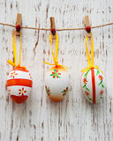 Easter eggs hanging on a line Royalty Free Stock Photos