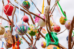 Easter eggs hanging from a metal tree. Ukrainian pysanky eggs with traditional design on them hanging from a metal tree Stock Image