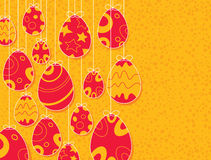 Easter eggs hanging. With orange background Royalty Free Stock Images