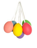 Easter eggs hanging on ribbon isolated on white Stock Photo