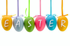 Easter eggs hanging on ribbons. Isolated. Stock Photography