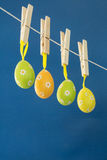 Easter eggs hanging from a washing line Stock Photo
