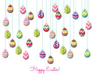 Easter eggs hanging on the wire background Royalty Free Stock Photo
