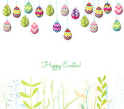 Easter eggs hanging on the wire and florals background Stock Photo