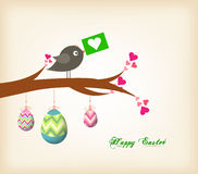 Easter eggs hanging on the wire greeting card with bird Stock Photos