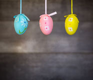 Easter. Eggs hanging on a wooden background stock image
