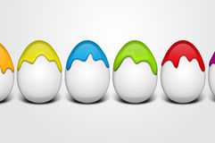 Happy easter eggs. Easter eggs with happy faces and dripping paint Royalty Free Stock Images