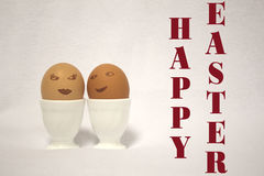 Easter eggs. HAPPY EASTER. easter eggs.  eggs painted like faces of a girl and a guy PASCUA Royalty Free Stock Images