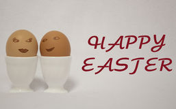Easter eggs. HAPPY EASTER. easter eggs.  eggs painted like faces of a girl and a guy PASCUA Royalty Free Stock Image