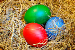 Easter eggs in hay Stock Image