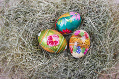 Easter eggs on hay Royalty Free Stock Image