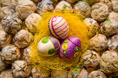 Easter eggs on hay. Easter egg with geometric patterns on yellow nest Stock Images