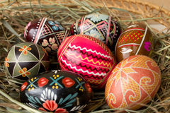 Easter eggs on hay Stock Photo