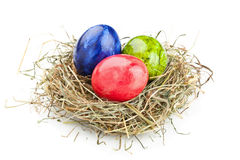 Easter eggs in hay nest Stock Photo