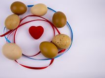 Easter eggs with a heart on a white background with free space to fill royalty free stock photos