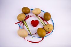 Easter eggs with a heart on a white background with free space to fill stock photo