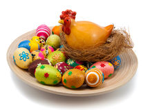 Easter eggs and hen with nest on plate Royalty Free Stock Photo