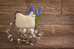 Easter eggs and hen. In nest on wooden background royalty free stock image