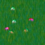 Easter eggs hidden in grass lawn Stock Photo