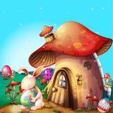 Easter eggs hidden near a mushroom-designed house Royalty Free Stock Photos