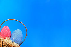 Easter eggs hunt. On blue background Royalty Free Stock Photo