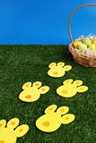 Easter eggs hunt with bunny tracks Royalty Free Stock Photography