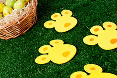 Easter eggs hunt with bunny tracks Royalty Free Stock Photo