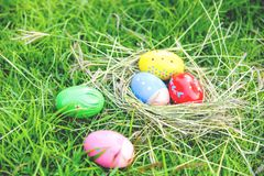 Easter eggs hunt on green grass outdoor Nest egg colorful decorated festive on meadow. Easter eggs hunt on green grass outdoor / Nest egg colorful decorated stock images