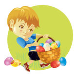 Easter eggs hunting. Young boy hunting and carrying a basket of Easter eggs Stock Photography