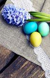 Easter eggs with hyacinth on wooden background in vintage style Stock Image