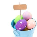 Easter eggs ib bucket with empty tag  isolated on white Stock Photo