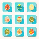 Easter eggs icons of different hue, set. Easter eggs icons, with a rabbit, a bird and ornament, different colors, a set Stock Image