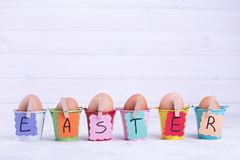 Easter Eggs In Colored Buckets Royalty Free Stock Photography