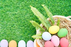 Easter Eggs In The Basket On Grass Royalty Free Stock Photos