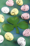 Easter eggs and an Irish shamrock Royalty Free Stock Images