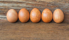 Easter eggs isolate on wood background. Stock Photos