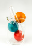 Easter eggs in lab glass Stock Photography