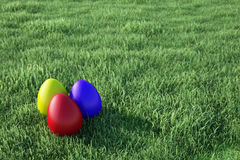 Easter Eggs laying in grass Stock Images