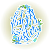 Easter eggs lettering and forget-me flowers Royalty Free Stock Images