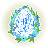 Easter eggs lettering and forget-me flowers Stock Photography