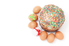 Easter eggs lie around cake on white background Royalty Free Stock Images
