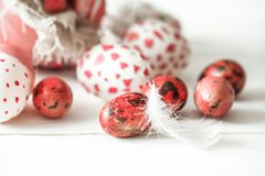 Easter eggs on a light wood background, Stock Photo