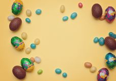 Easter eggs like a background. Chocolate Easter eggs, sweets on wooden background stock photo