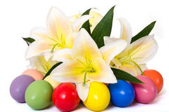 Easter eggs and lily. Colored Easter eggs and easter lily on white background Royalty Free Stock Photo