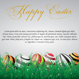 Easter eggs with lines in grass on a white shining background wi. Th flowers. With text Royalty Free Stock Image