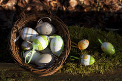 Easter Eggs in little basket on green grass Stock Photo