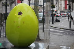 Easter Eggs in London city center - clock. Easter Eggs put in different places of London city center. Eggs with different motives and decoration technique. Photo Stock Images
