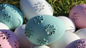 Easter eggs. Lot of Easter eggs pastel colors, white, pink, purple  and green in the garden a sunny day Royalty Free Stock Images